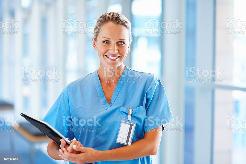 Happy female nurse holding reports royalty-free stock photo