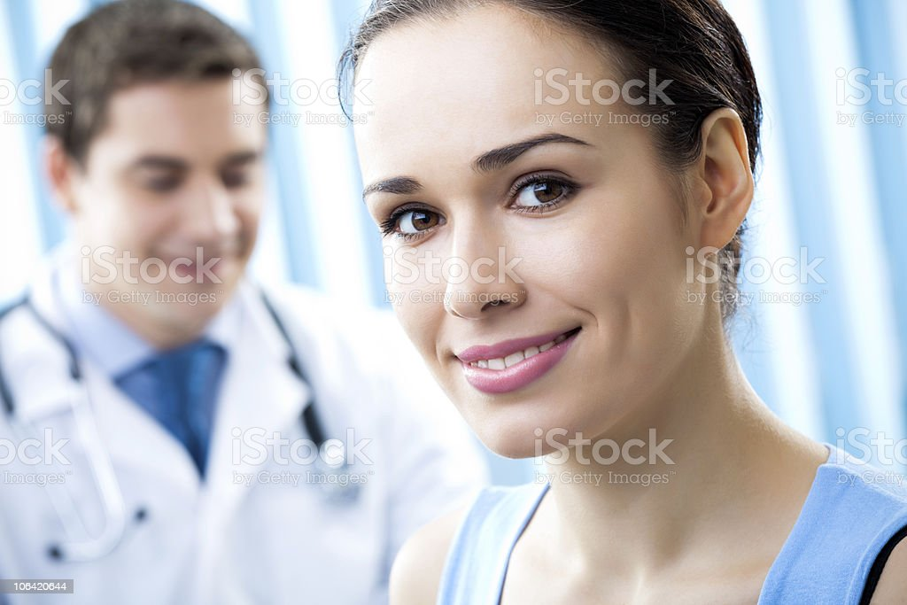 Happy female patient and doctor at office royalty-free stock photo
