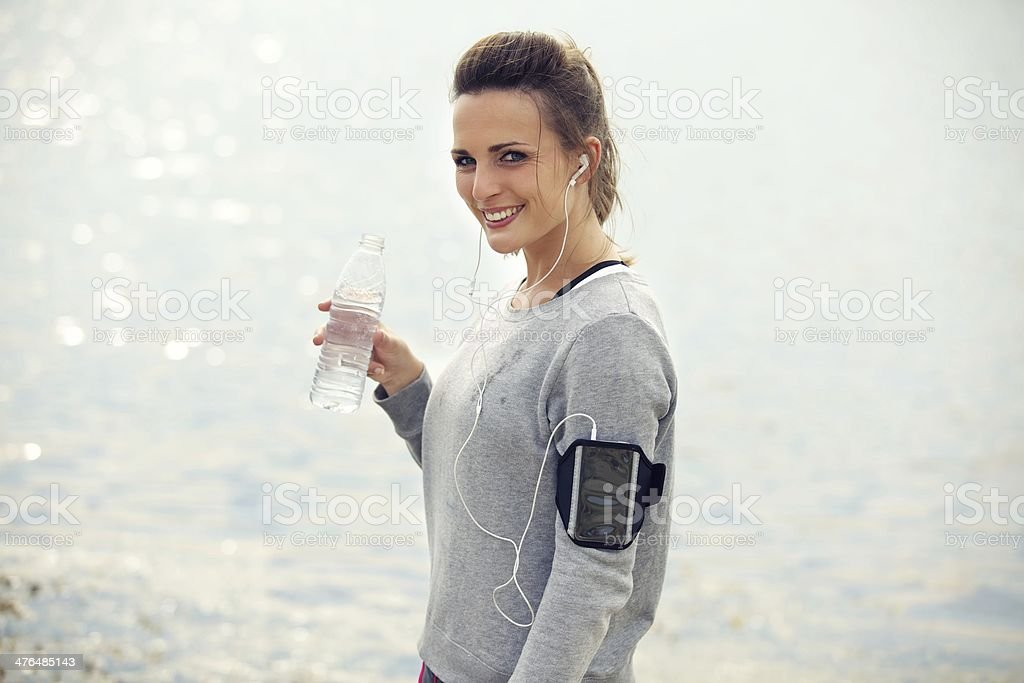 Happy Female Runner with Bottled Water royalty-free stock photo