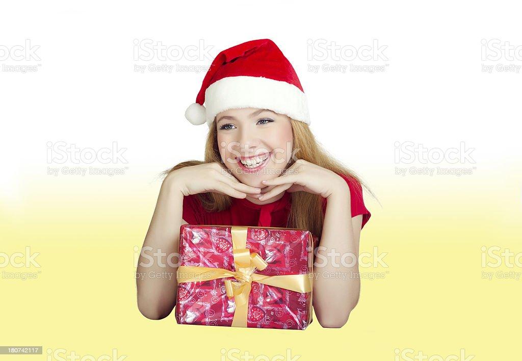 Happy female Santa with Christmas gift royalty-free stock photo