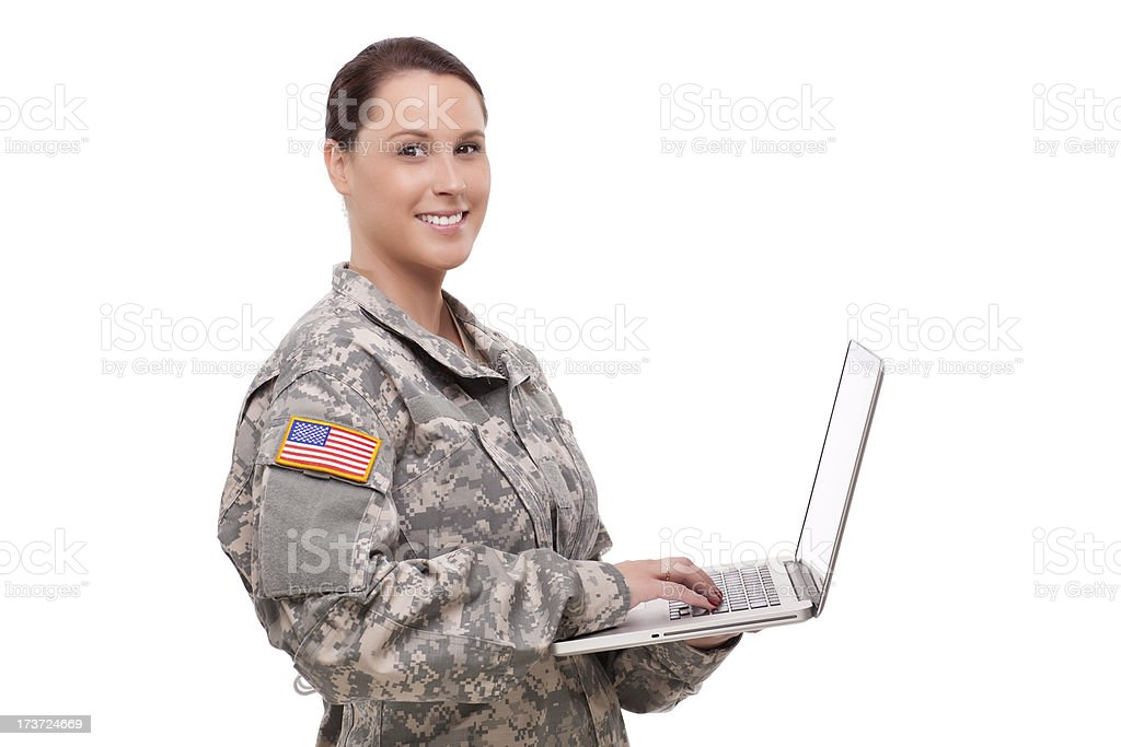 Happy female soldier using laptop royalty-free stock photo