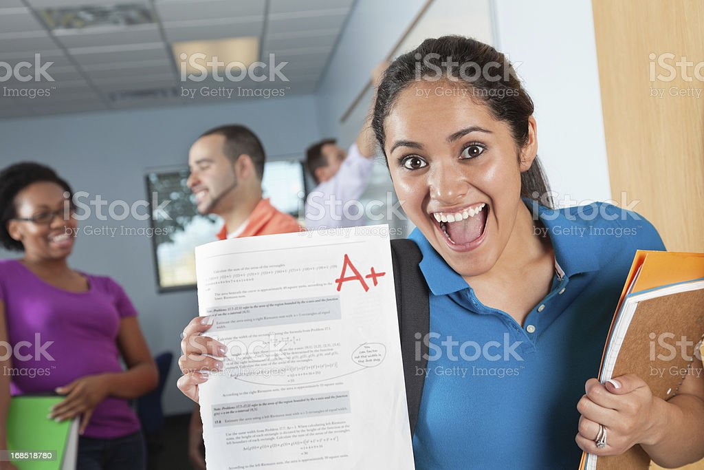 Happy Female Student in Class With Great Test Grade stock photo
