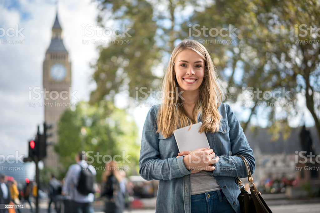 Happy female student in London stock photo