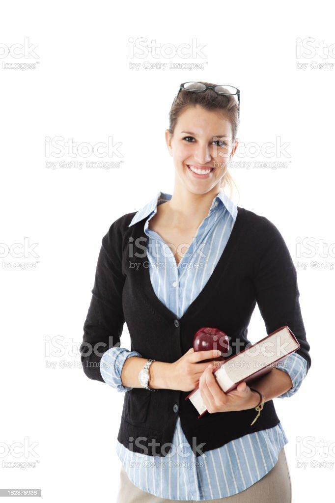 Happy Female Teacher Holding Apple and Book stock photo