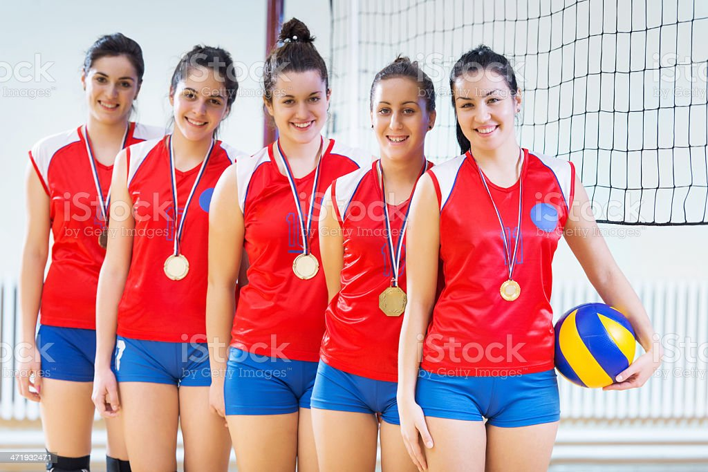 Happy female volleyball team. royalty-free stock photo