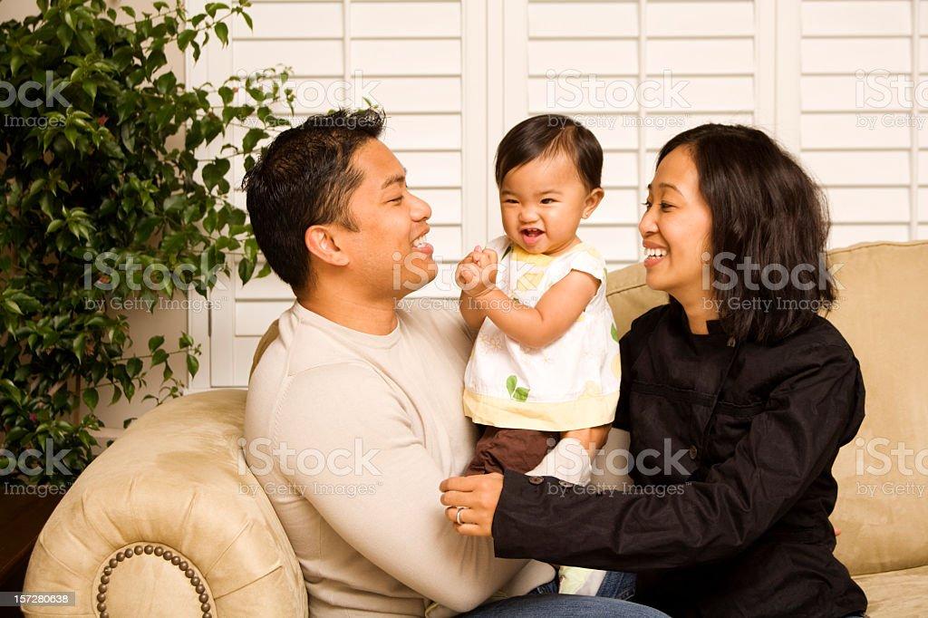 Happy Filipino family at home royalty-free stock photo