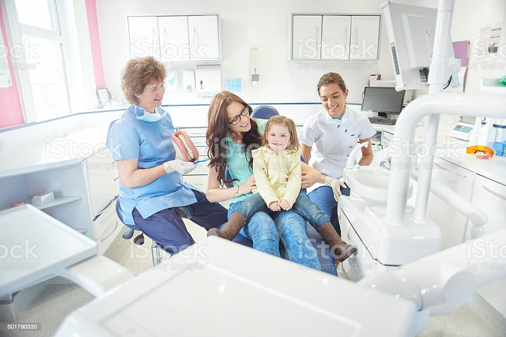 happy first dental visit stock photo