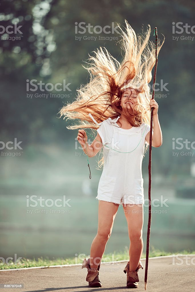 happy fisher woman laughing stock photo