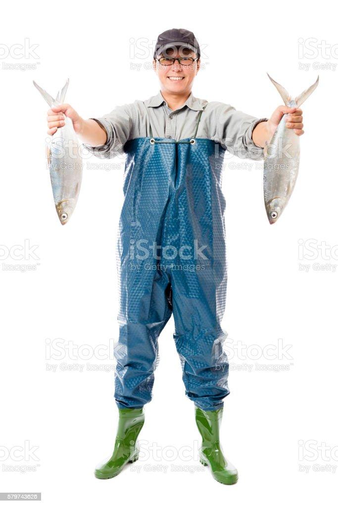 happy fisherman showing big fish isolated on white stock photo
