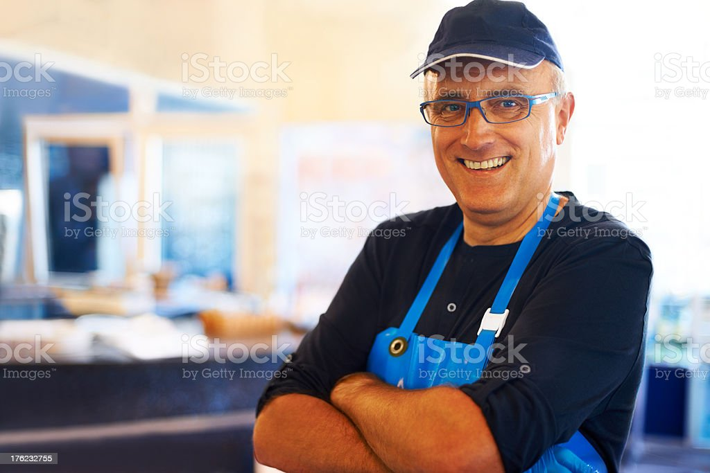 Happy fishmonger smiling stock photo