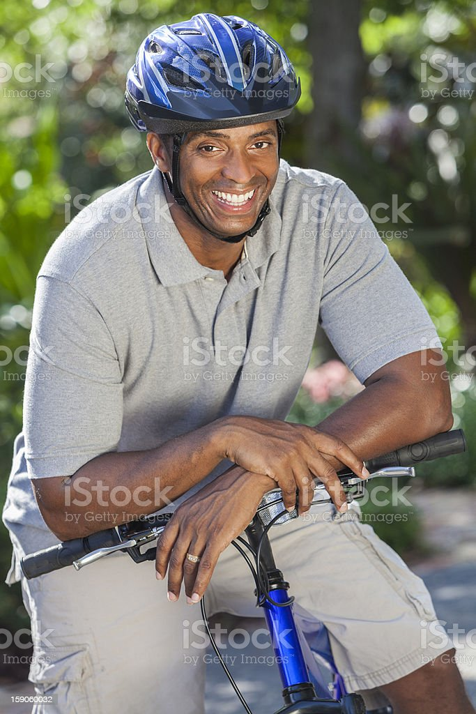 Happy Fit African American Man Riding Bike royalty-free stock photo