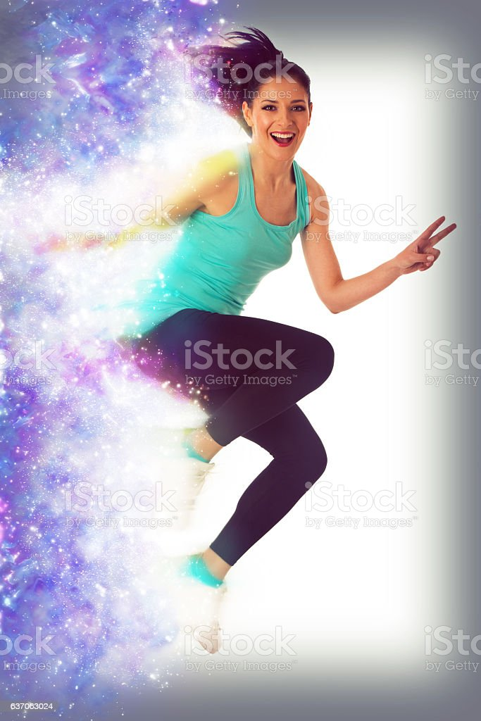 Happy fit woman dancing and jumping isolated over white stock photo