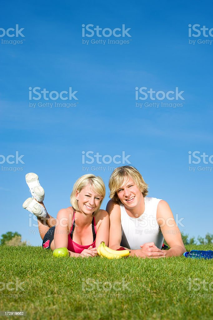 Happy Fitness Couple in Park royalty-free stock photo