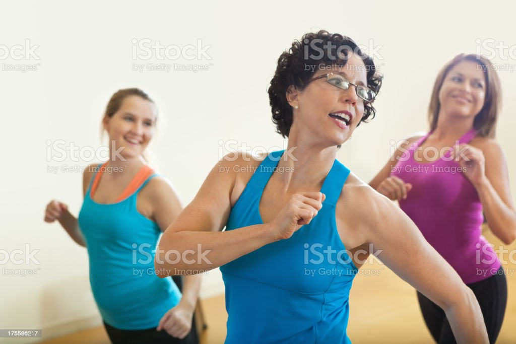 Happy fitness instructor teach in class to smiling students stock photo