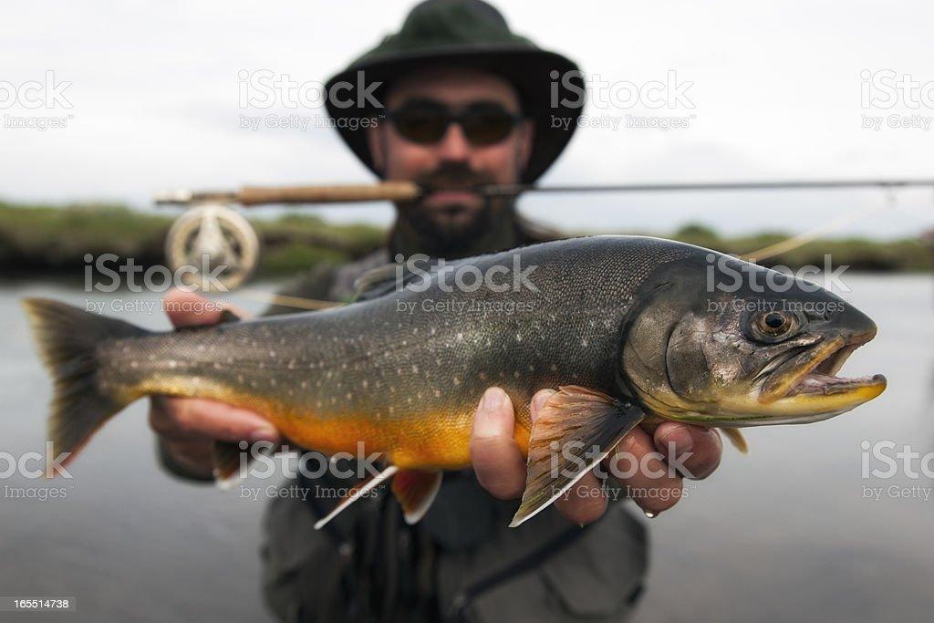 Happy flyfisherman stock photo