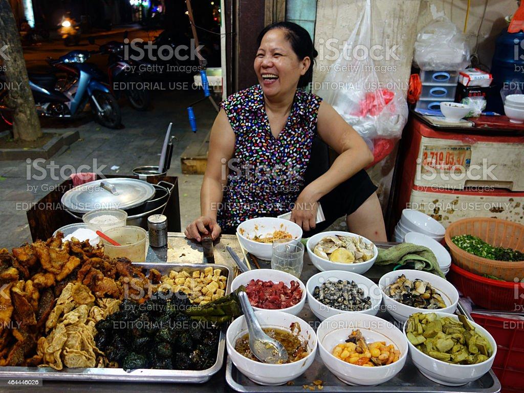 Happy food vendor, Hanoi, Vietnam stock photo