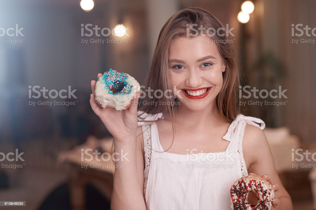 happy for having these delicious donuts stock photo