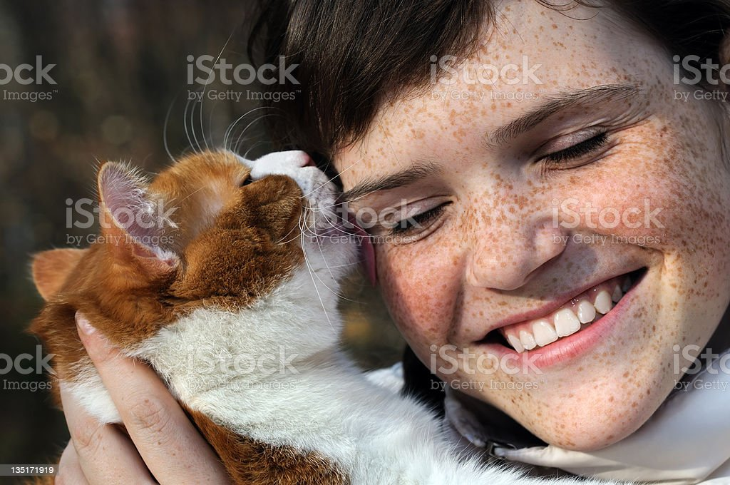 happy freckled girl and funny red cat royalty-free stock photo
