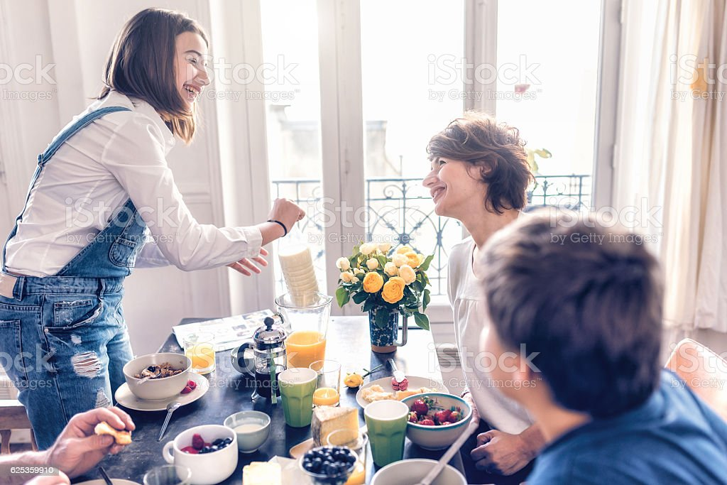 happy french family having breakfast together stock photo