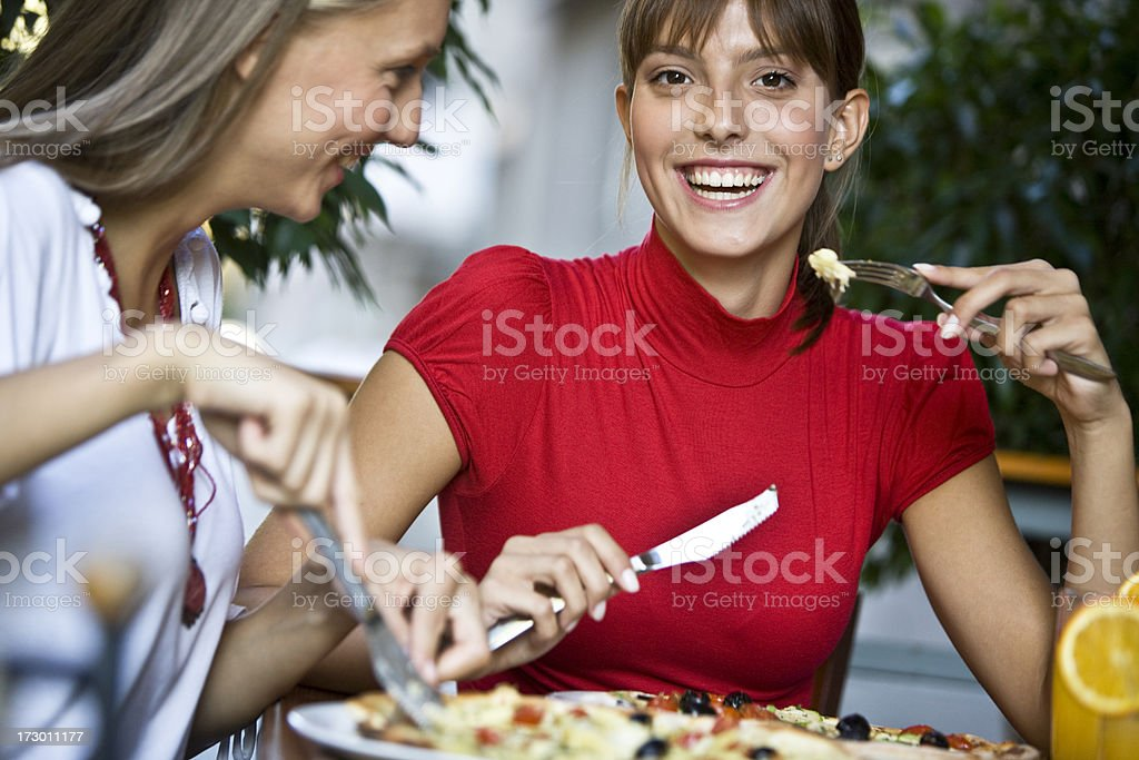 Happy friends at restaurant XXL royalty-free stock photo