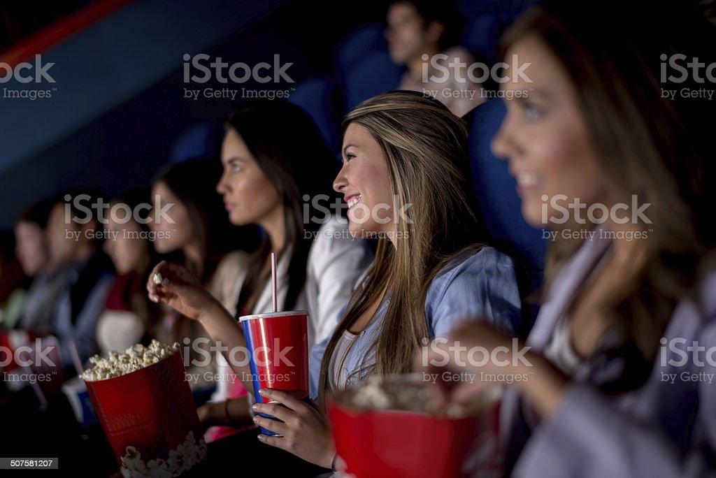 Happy friends at the cinema stock photo