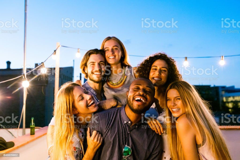 Happy friends at the rooftop party stock photo
