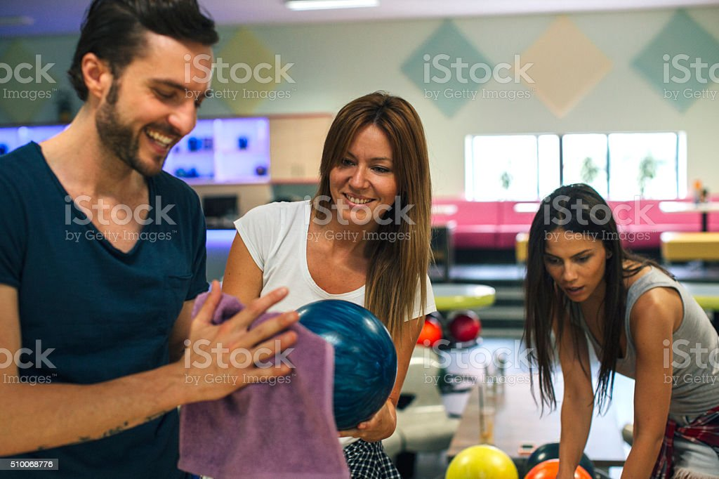 Happy Friends Bowling Together. stock photo