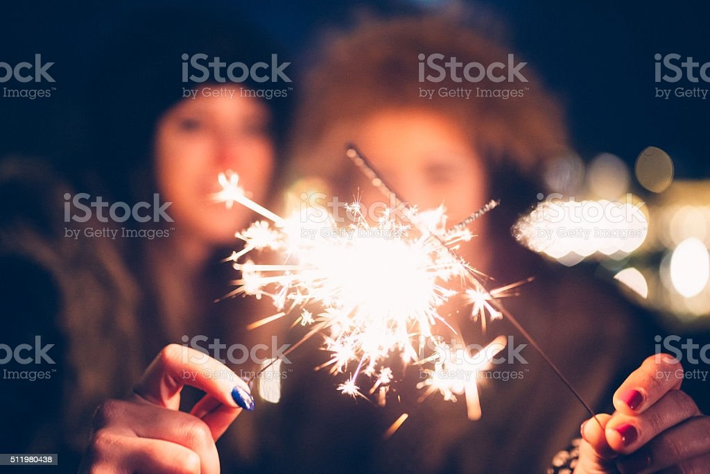 Happy Friends Celebrate Together With Sparklers stock photo