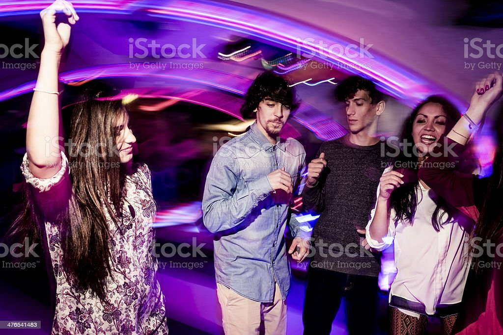Happy friends dancing in the nightclub. royalty-free stock photo