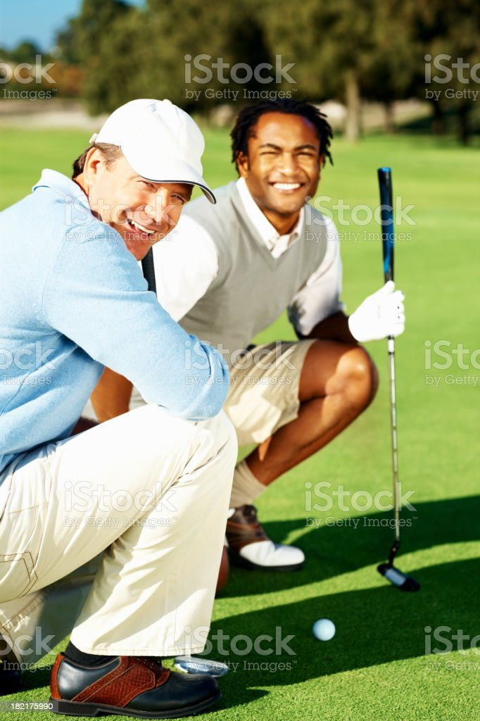 Happy friends enjoying a game of golf royalty-free stock photo