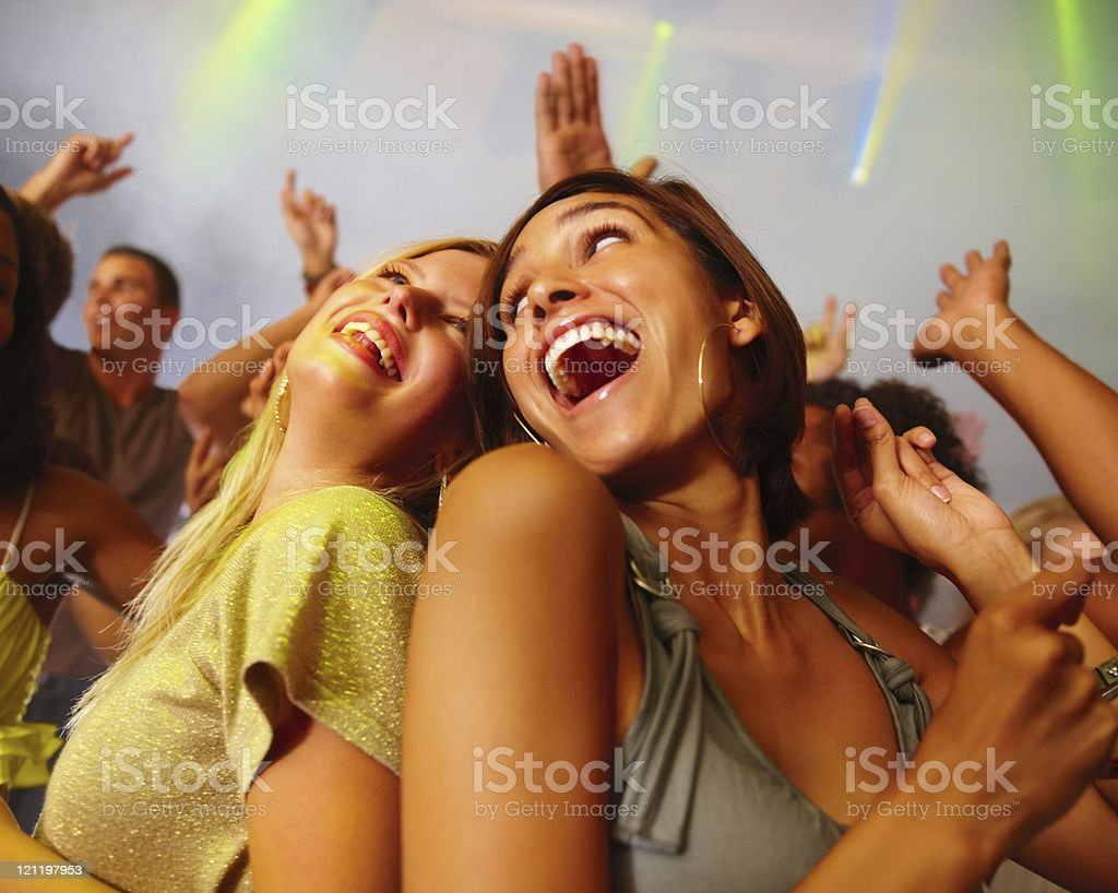 Happy friends enjoying at the nightclub royalty-free stock photo