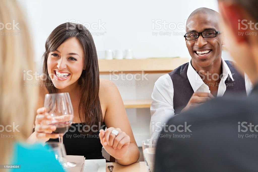 Happy friends enjoying dinner at a nice restaurant royalty-free stock photo