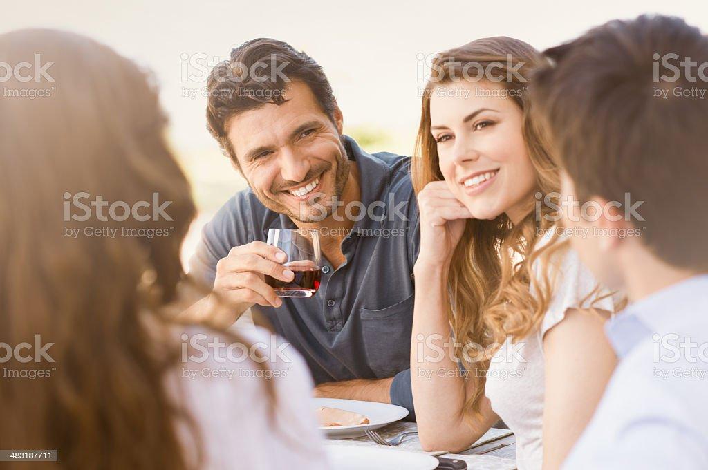 Happy Friends Enjoying Dinner stock photo
