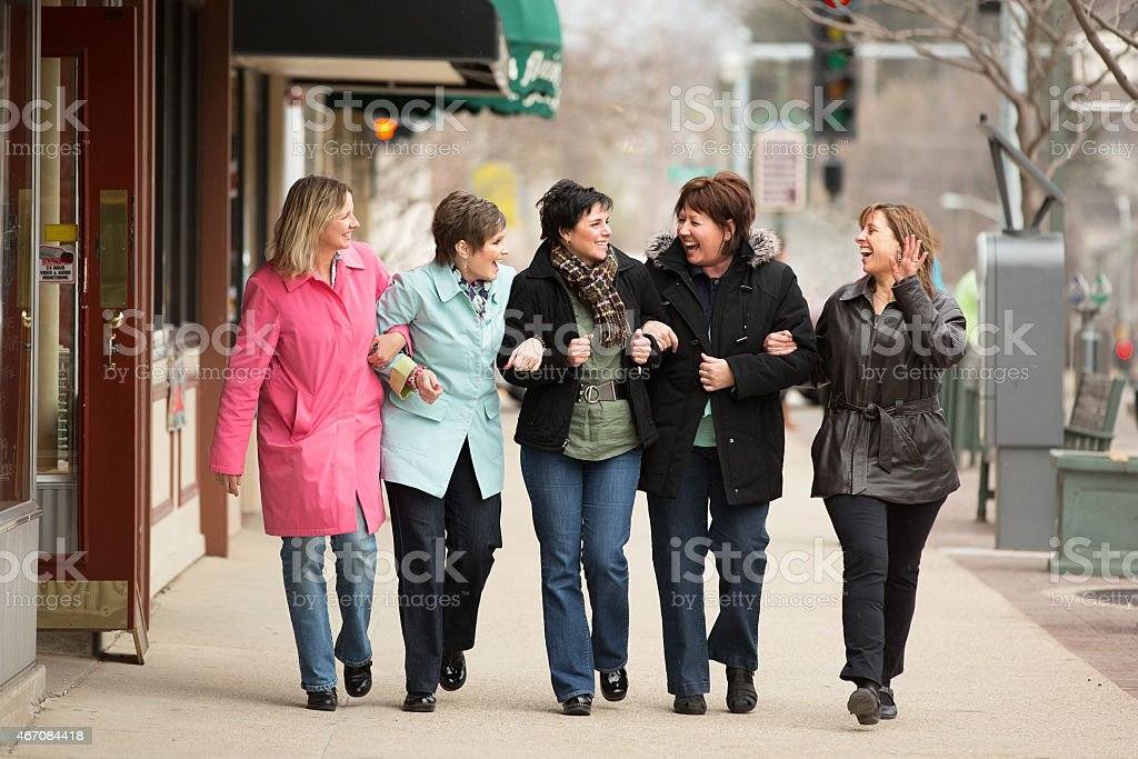 Happy friends hanging out together stock photo