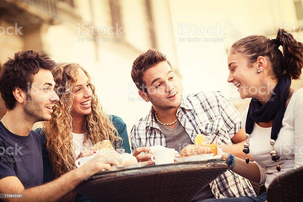 Happy Friends having a Traditional Italian Breakfast royalty-free stock photo