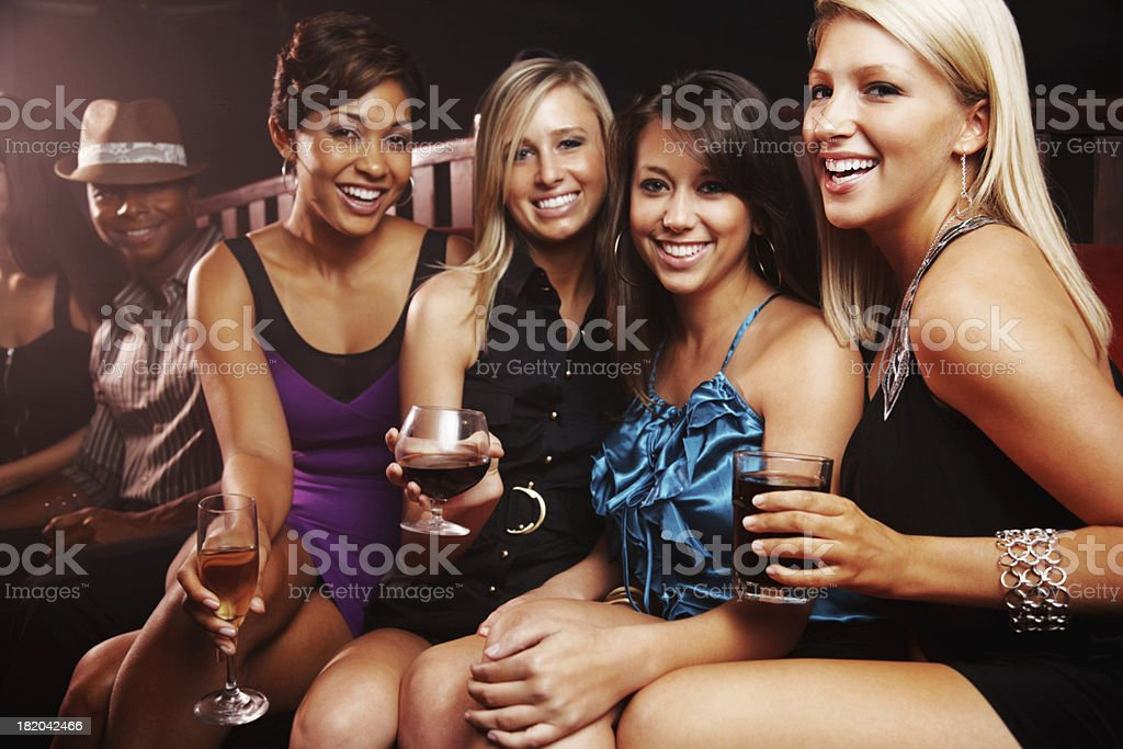 Happy friends having big night out in a bar royalty-free stock photo