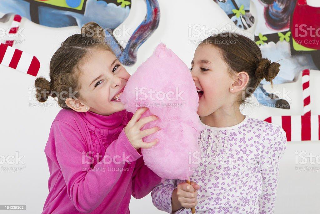 Happy friends having fun at amusement park - studio shot stock photo