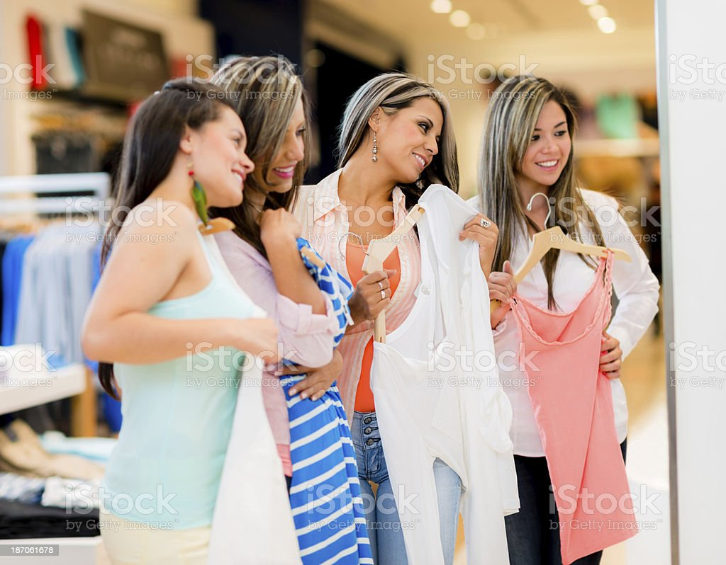 Happy friends in a clothing store stock photo