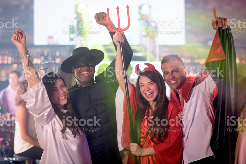 Happy friends in a Halloween party stock photo