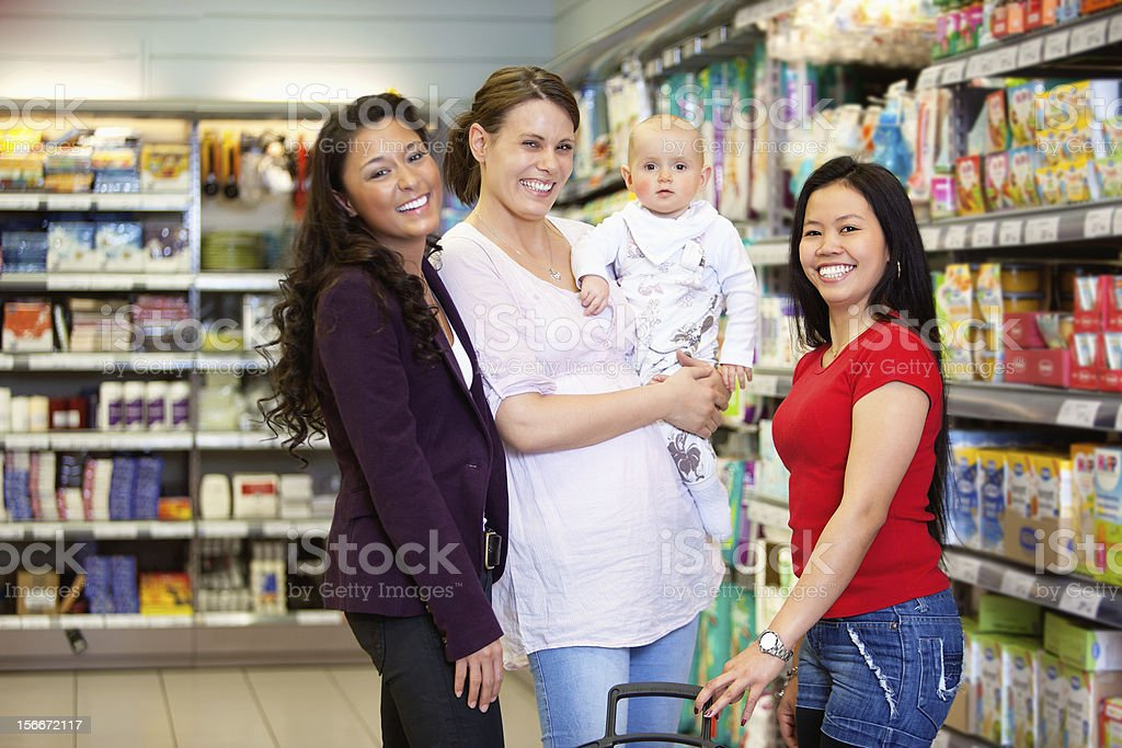 Happy Friends in Grocery Store royalty-free stock photo