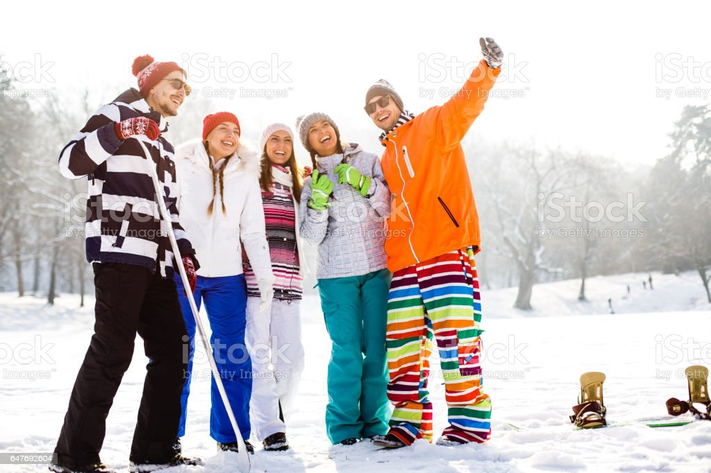Happy friends in snow stock photo