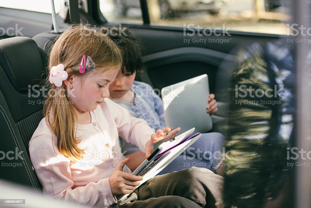 Happy friends in the car. stock photo
