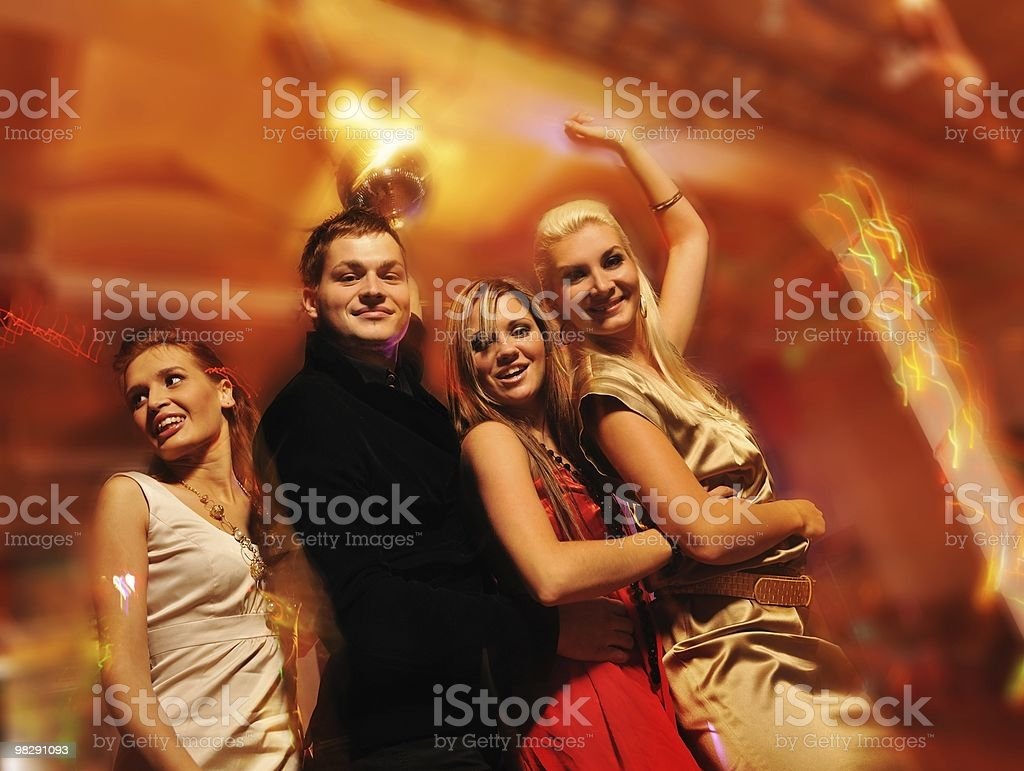 Happy friends in the night club stock photo