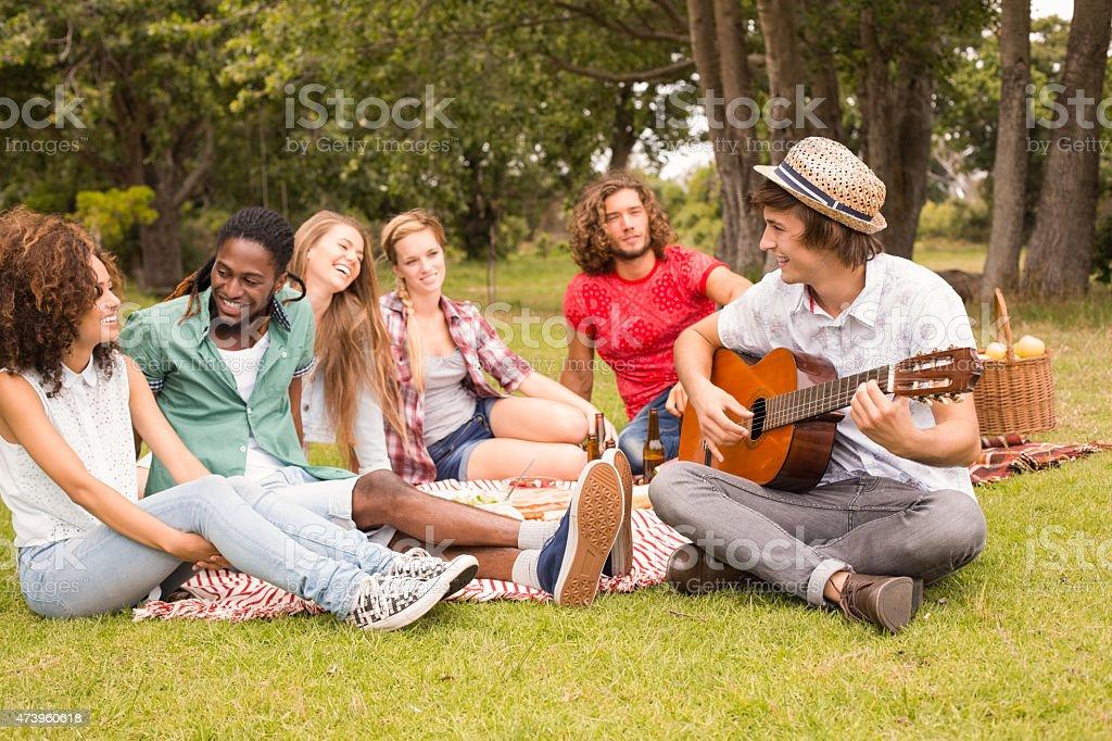 Happy friends in the park having picnic stock photo