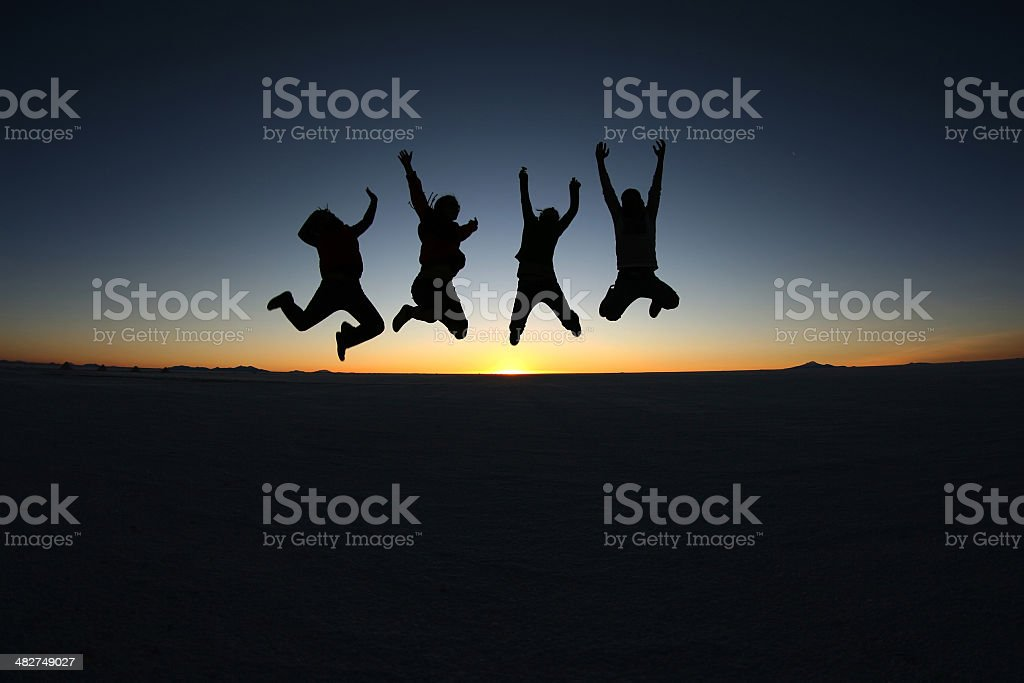 Happy friends jumping outdoor royalty-free stock photo