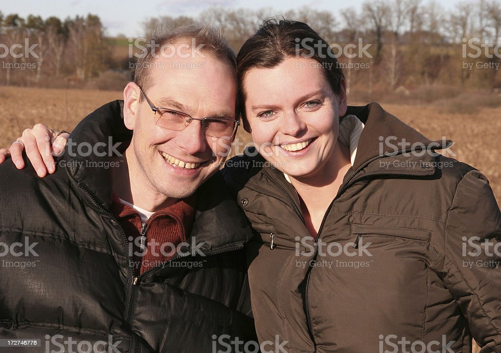 happy friends looking at camera royalty-free stock photo