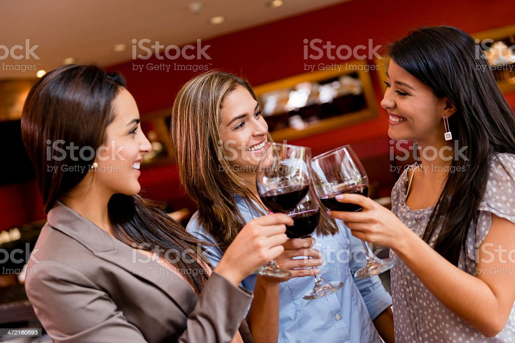 Happy friends making a toast stock photo