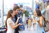 Happy friends meeting in the street