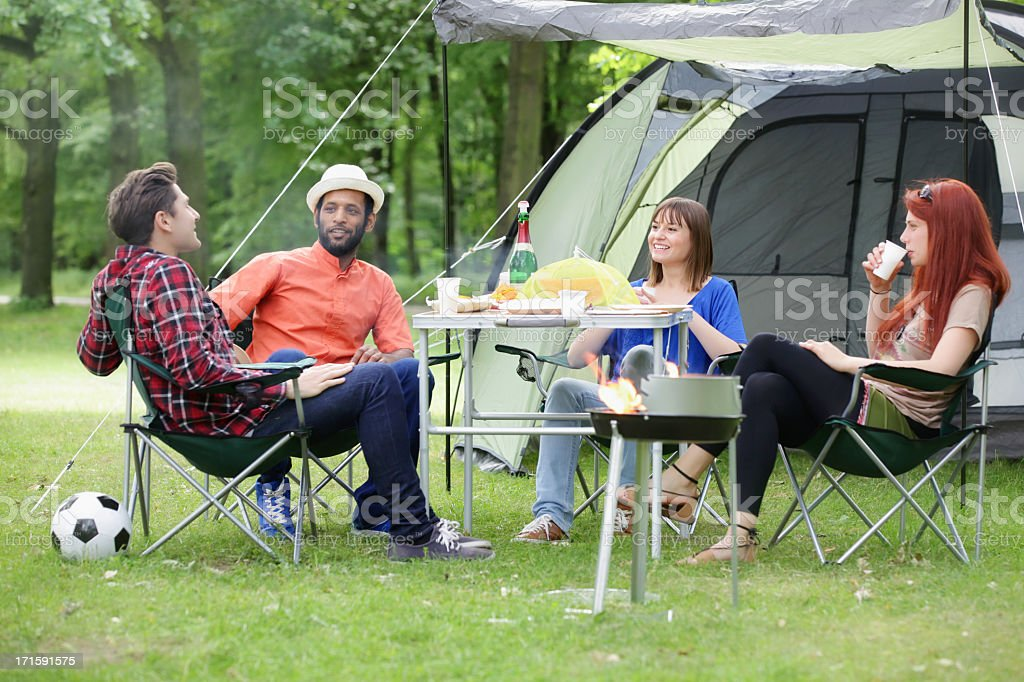 Happy Friends on a Camping Trip royalty-free stock photo