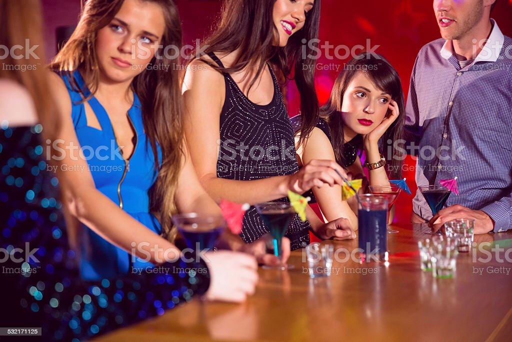 Happy friends on a night out together stock photo